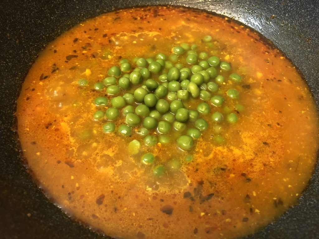Add boiled peas to the matar masala