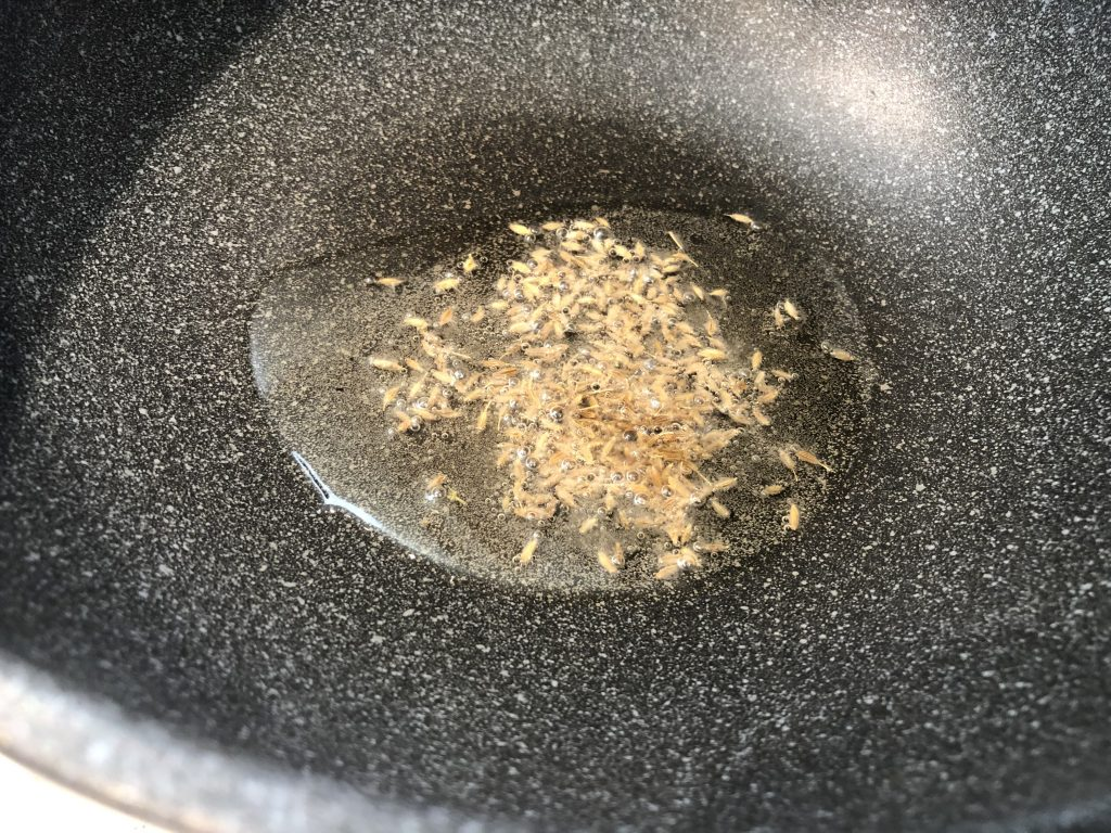 Add cumin seeds to oil