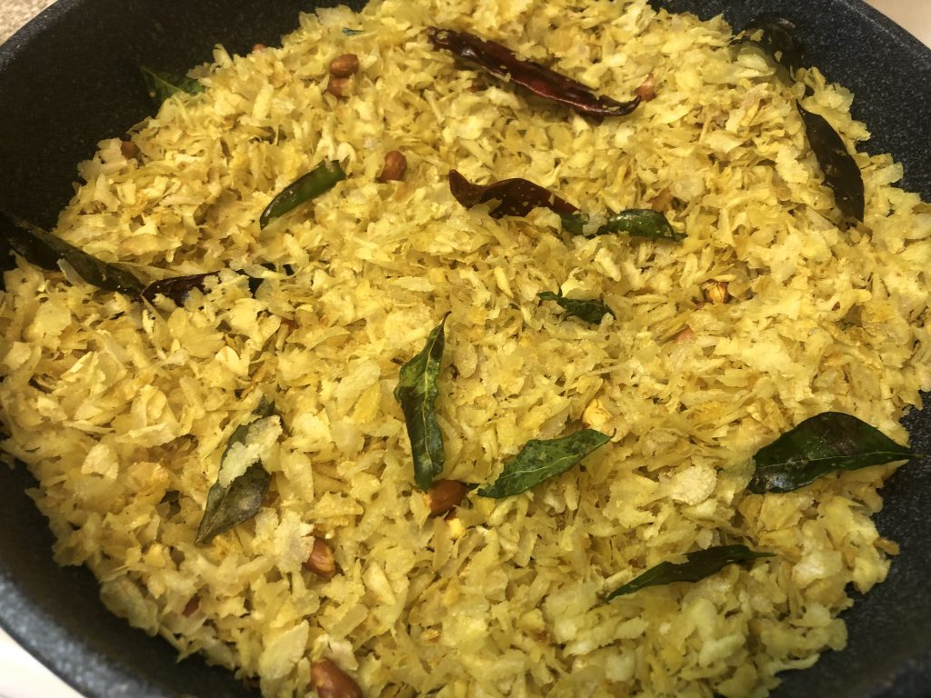 Add poha to the pan for poha chivda