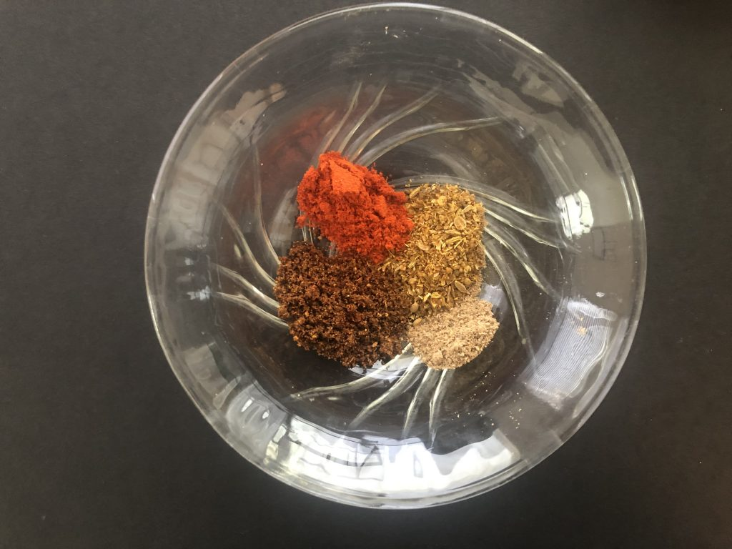 Places spices in Bowl