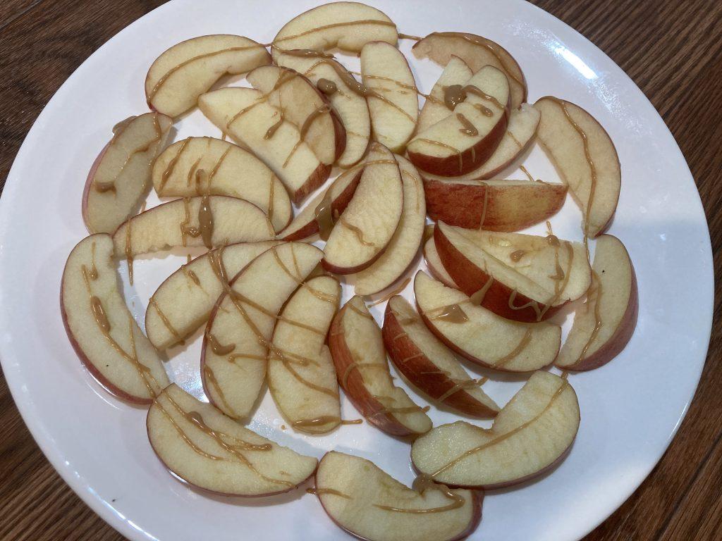 Apple Nachos - Spread peanut butter
